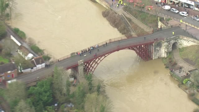 exterior aerial views of flooding in ironbridge, showing the high water level and flood defence system on 26 february 2020 in telford, united kingdom - ironbridge shropshire stock videos & royalty-free footage