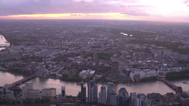 exterior aerial views of london looking west as the sun sets including westminster battersea power station and the river thames on 4 september 2019... - river thames stock videos & royalty-free footage