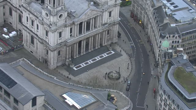 exterior aerial views of stpauls cathedral showing the empty entrance during the covid19 outbreak as london streets remain largely deserted during... - twilight stock videos & royalty-free footage