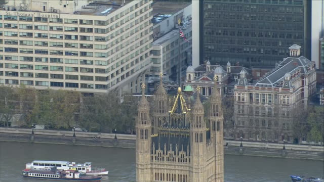 exterior aerial views of the houses of parliament seen on budget day also including close up of victoria tower on october 29 2018 in london england - victoria tower stock videos & royalty-free footage