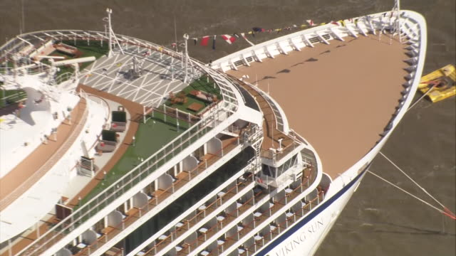 exterior aerial views of the the viking sun cruise liner, docked in greenwich on the river thames, waiting to leave on the longest ever cruise voyage... - cruising video stock e b–roll