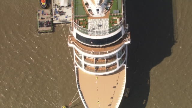 exterior aerial views of the the viking sun cruise liner docked in greenwich on the river thames waiting to leave on the longest ever cruise voyage... - cruising stock videos & royalty-free footage