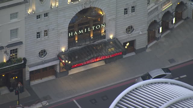 exterior aerial views of the victoria palace theatre, showing hamilton advertising and a nearby pub closed during the covid-19 outbreak as london... - performance stock videos & royalty-free footage