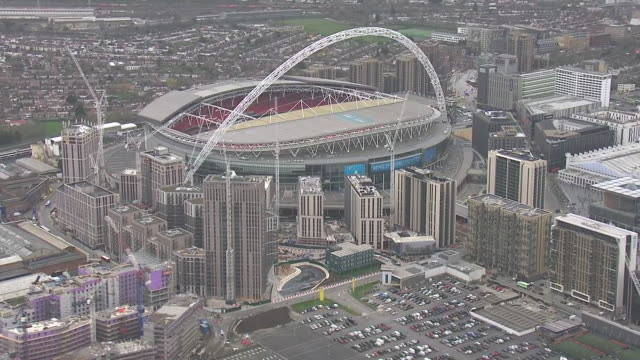 exterior aerial views of wembley stadium and surrounding buildings and complex after uefa announced that euro 2020 was being cancelled due to covid19... - arch stock videos & royalty-free footage