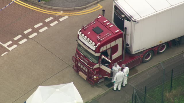 exterior aerials of lorry container where 39 bodies were found inside and surrounding crime scene at waterglade industrial park on the 23 october... - articulated lorry stock videos & royalty-free footage