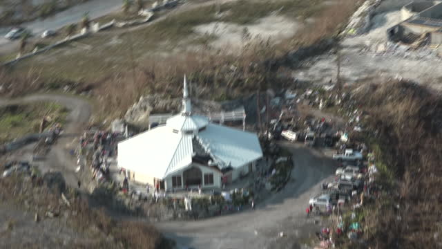 exterior aerials of the devastation caused by hurricane dorian; destroyed houses, buildings and boats and debris covering land on 5 september 2019 in... - bahamas stock videos & royalty-free footage