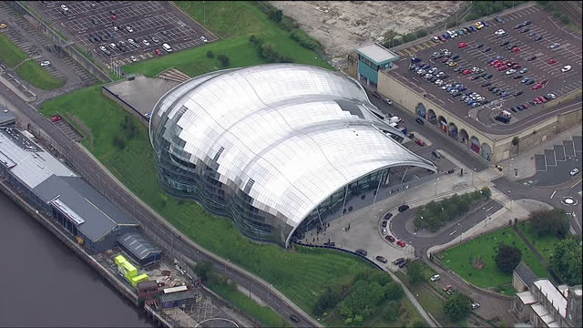 exterior aerials of the sage venue in gateshead gateshead millennium bridge ** this clip is mute ** on september 03 2015 in gateshead england - gateshead stock videos and b-roll footage