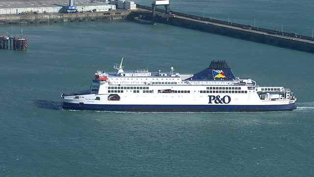 Exterior aerials P O ferry sailing into the Port of Dover with the White Cliffs of Dover in the background Footage shows the Peninsular and Oriental...