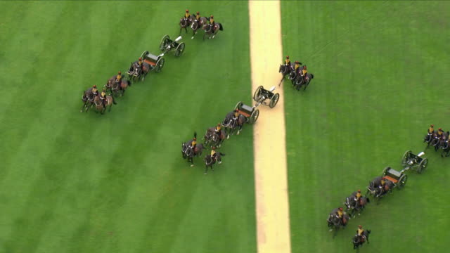 exterior aerials shots of king's troop royal horse artillery riding into hyde park and putting in position the 13pounder field guns for 41round... - king royal person stock videos and b-roll footage