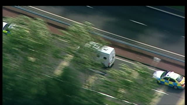 stockvideo's en b-roll-footage met exterior aerials showing al megrahi's police van being surrounded by convoy on august 20 2009 in greenock scotland - dumfries en galloway