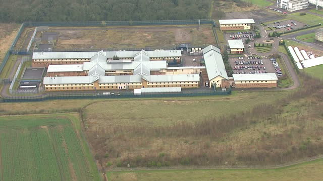 exterior aerials shows yarl's wood immigration detention centre large secure buildings in rural setting on march 20 2014 in bedford england - prisoner uk stock videos & royalty-free footage