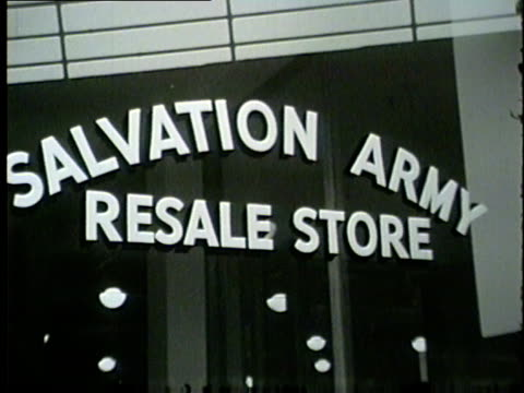 exterior and interior of a salvation army resale store in chicago in 1954 - 1954 bildbanksvideor och videomaterial från bakom kulisserna