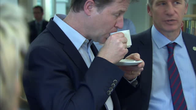 vídeos de stock e filmes b-roll de exterior and interior shots nick clegg deputy prime minister and liberal democrat party leader visiting penrice academy in st austell talking to... - st austell