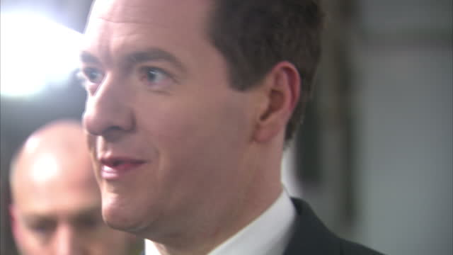 exterior and interior shots of chancellor george osborne walking aboard a royal navy ship and greeting naval seamen on board on january 30 2015 in... - 英国ハンプシャー点の映像素材/bロール
