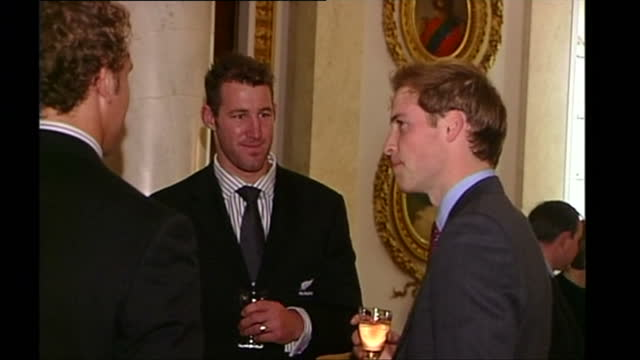 exterior and interior shots of the new zealand rugby team all blacks arriving and chatting to prince william during a special reception at buckingham... - british royalty stock videos & royalty-free footage