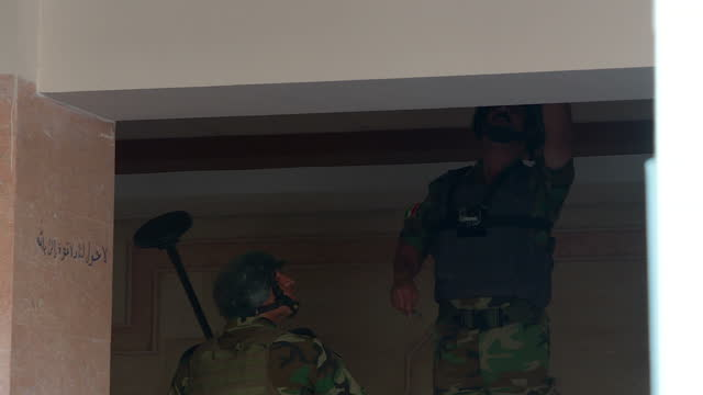 exterior and interior shots peshmerga forces checking area liberated from islamic state looking slowly for bombs and booby traps interior shots bomb... - isis stock videos and b-roll footage
