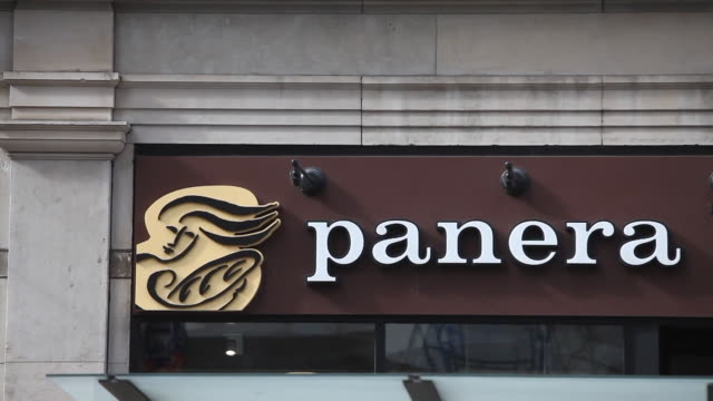 Exterior and signage shots of a Panera Bread store location in New York NY Shots of customers and commuters wearing warm winter clothing while...