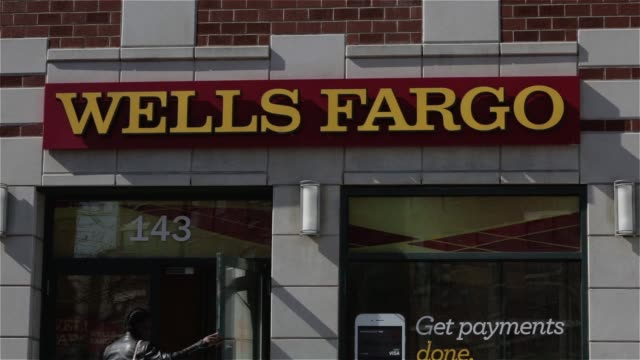 exterior and signage shots of a wells fargo bank branch in new york new york us on april 13th 2015 shots close up shots of wells fargo signage above... - wells fargo stock videos and b-roll footage