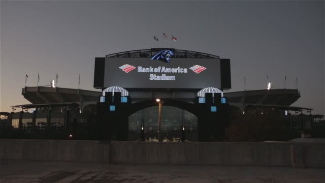 Exterior and signage shots of Bank of America Stadium lit up at night in Charlotte North Carolina on Game Day between the Carolina Panthers and the...
