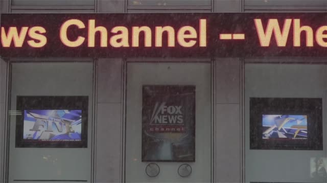 exterior and signage shots of fox headquarters at 1211 avenue of the americans or the news corporation headquarters in new york ny on a snowy monday... - base stock videos & royalty-free footage