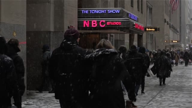 exterior and signage shots of nbc headquarters at rockefeller center in new york ny on a snowy monday february 15th 2016 photographer ara ayer... - nbcuniversal stock videos & royalty-free footage