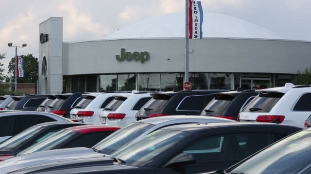 exterior and signage shots of the cross chrysler jeep dealership in louisville kentucky us on monday june 29 2015 shots close up shots of jeep... - autohandlung stock-videos und b-roll-filmmaterial
