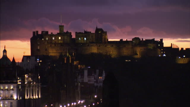 exterior arty shot of edinburgh castle at sunset with purple sky in the background on december 20 2016 in edinburgh scotland - edinburgh castle stock videos & royalty-free footage