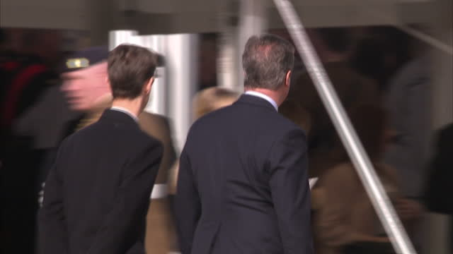 exterior back view shot of david cameron, former prime minister walking at war memorial service which honoured the service and duty of both the uk... - war stock-videos und b-roll-filmmaterial