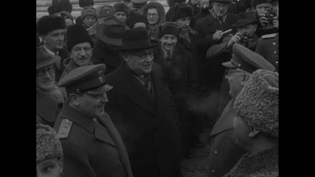 VS exterior Belorussky Rail Station in Moscow / train arrives at platform / female police guard train conductor / British FM Ernest Bevin wearing hat...
