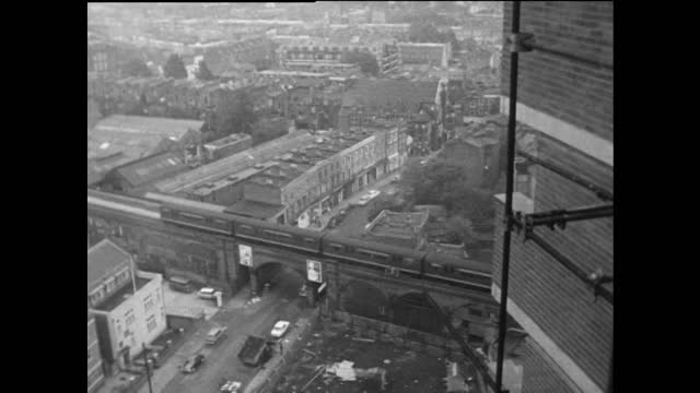 has exterior  block of flats being built and london cityscape; 1967 - rail transportation stock videos & royalty-free footage