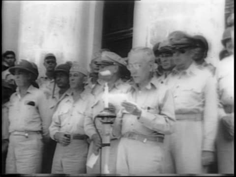 Exterior Capitol Building in Leyte / Philippines President Sergio Osmena speaks to a crowd of troops and General Douglas MacArthur / Osmena proclaims...