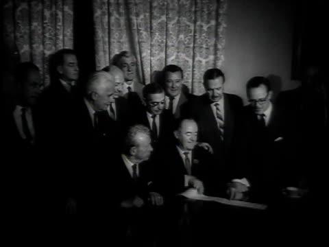 vidéos et rushes de exterior capitol hill / senators smiling holding voting paper / votes on paper - 1964