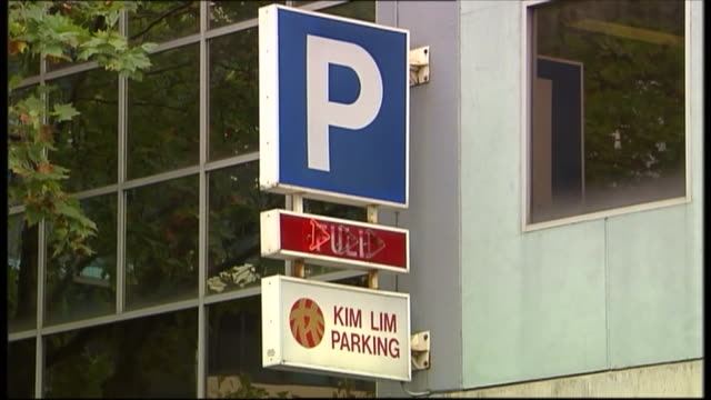 exterior car park entrance and signage - kim lim parking - was the carpark from which a car fell and was wedged between buildings - personal land vehicle stock videos & royalty-free footage