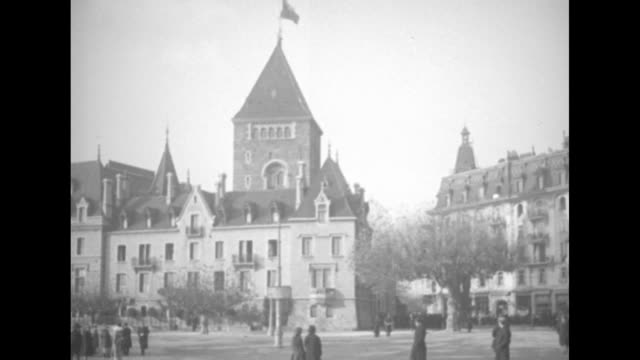 ms exterior chateau d'ouchy where the allies will participate in grecoturkish war peace talks people milling around outside / pan rooftops of... - alliierte stock-videos und b-roll-filmmaterial