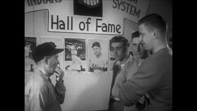 exterior cleveland indians farm system club house / players being served dinner / rookies looking at pictures of cleveland hall of famers / players... - spring training stock videos & royalty-free footage