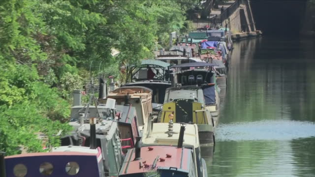 Exterior close up shots of canal boats and houseboats parked along Regent's Canal on 10th June 2018 in Maida Vale London United Kingdom