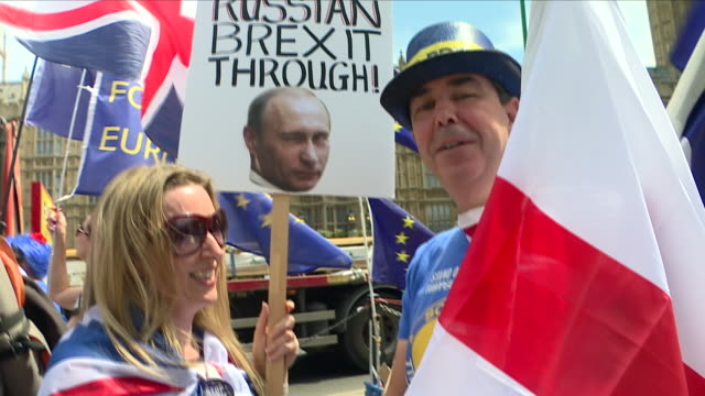exterior close up shots of demonstrators gathered holding union jack and european union flags in a 36 hour anti brexit protest including shots of... - brexit stock videos & royalty-free footage
