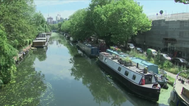 Exterior close up shots of houseboats docked along Regent's Canal on 10th June 2018 in Maida Vale London United Kingdom