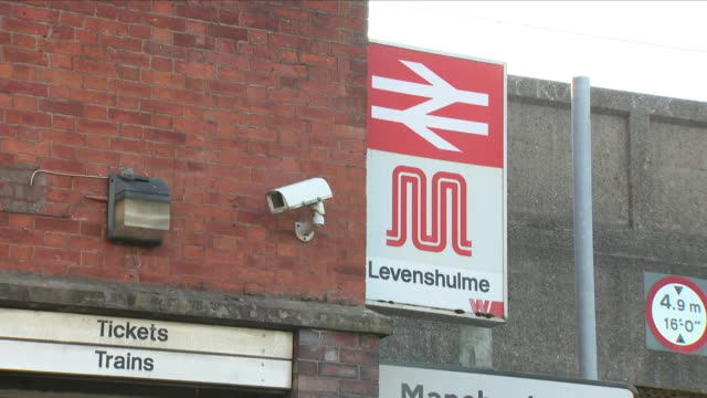 exterior close up shots of levenshulme railway station including close up shots of an information board outside the train station highlighting 'the... - street name sign stock videos & royalty-free footage