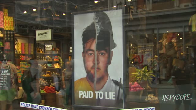 Exterior close up shots of the anti police 'Paid to Lie' campaign on display in the Lush store shop window with people walking past on 2nd June 2018...