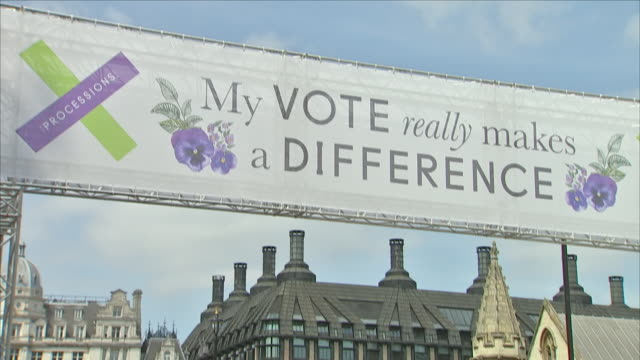 Exterior close up shots of the 'My Vote really makes a difference' banner hanging above the street and next to The Houses of Parliament to mark the...
