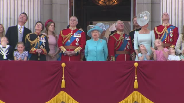 exterior close up shots of the queen walking onto the balcony at buckingham palace followed by prince william catherine duchess of cambridge prince... - queen royal person stock videos & royalty-free footage