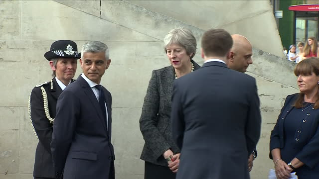 Exterior close up shots of Theresa May Sajid Javid and Sadiq Khan speaking to guests during the memorial service held to mark the 1 year anniversary...