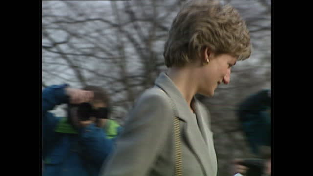 exterior close up shots princess diana departs hyde park police station wearing grey skirt suit and holding flowers, smiling, gets into back of car... - grey colour stock videos & royalty-free footage
