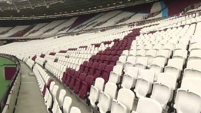 exterior close ups and various shots of london stadium seats. at olympic stadium on november 01, 2016 in london, england. - グランドキーパー点の映像素材/bロール