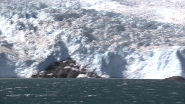 exterior close-up shots of a glacier on the kenai peninsula from a boat in the gulf of alaska on a clear sunny day on 15th september 2015 in alaska,... - kenai peninsula stock videos & royalty-free footage