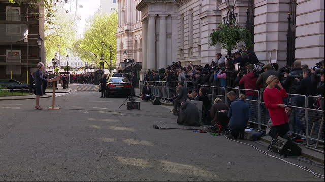 Exterior cutaway shots of Theresa May speaking outside Number 10 Downing Street to announce a snap general election to be held on the 8th of June on...