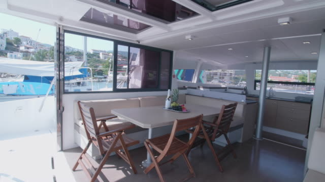 exterior dining room on a sailboat boat. - dining room stock videos & royalty-free footage