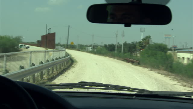 exterior driving shot alongside the texan side of the us mexico border with members of the us border patrol on august 27 2014 in rio grande city texas - border patrol stock videos & royalty-free footage