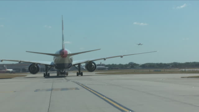 exterior driving shots along a heathrow taxiway past various planes including british airways air india and a stationary concorde on 25 june 2018 in... - taxiway stock-videos und b-roll-filmmaterial